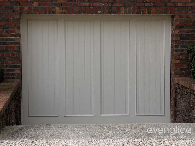 Timber Tilt Door With Routered Lines And Panel Moulds Garage Door