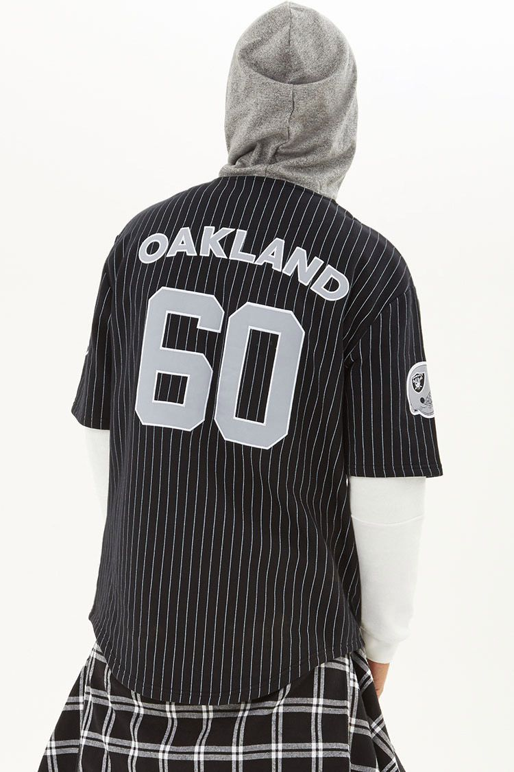 From our NFL collection, this fleece knit pinstripe shirt is complete with  a