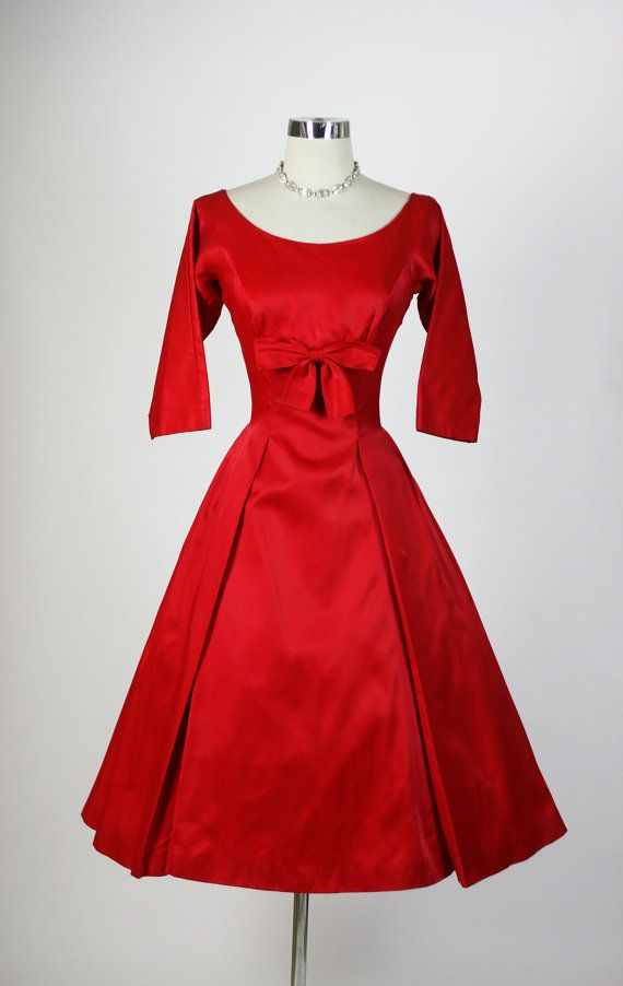 A glorious 1950s red-satin long sleeved dress.