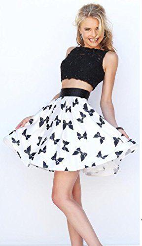 ebe2ac1967 Amazon.com  Cute Bowknot Print Mini Skirt Flared Pleated Short Skirt for  Women Girls  Clothing