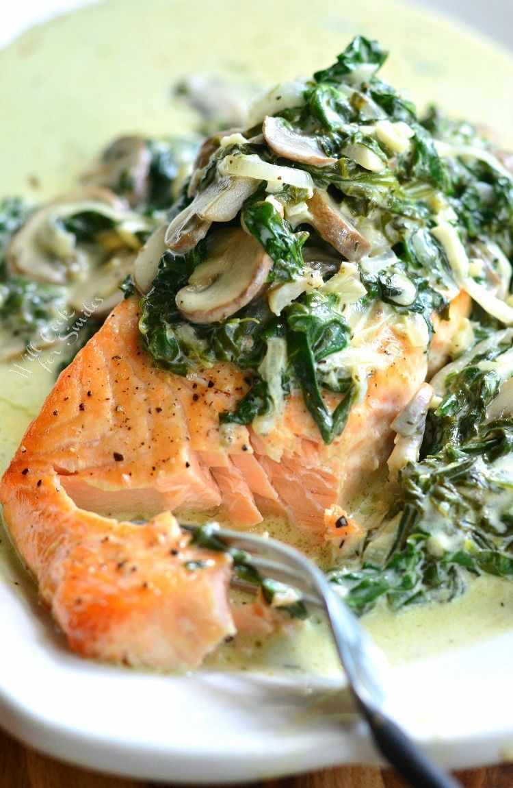 Salmon Florentine recipe is made with tender baked salmon and topped with creamy spinach and mushroom sauce. It's easy to make in about 20 minutes.