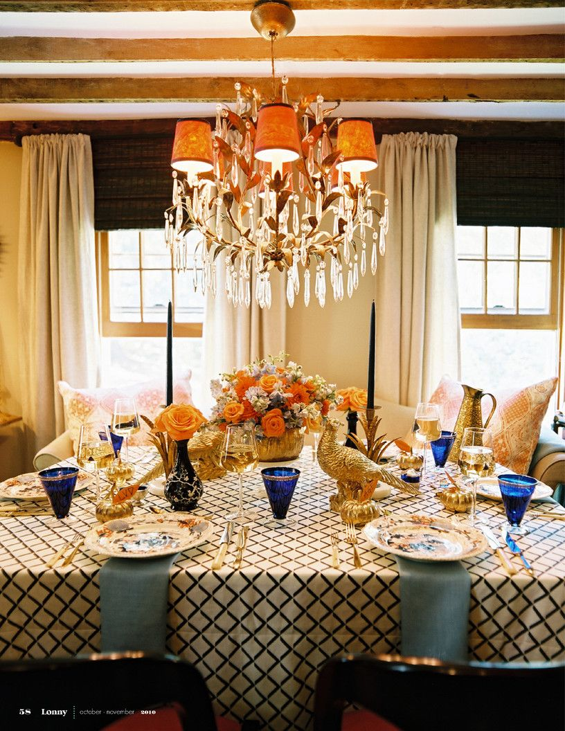 Eddie Ross And Jaithan Kochar - A dining table set for Thanksgiving below a crystal chandelier & I do no usually like shades on chandeliers but I LOVE THIS ...