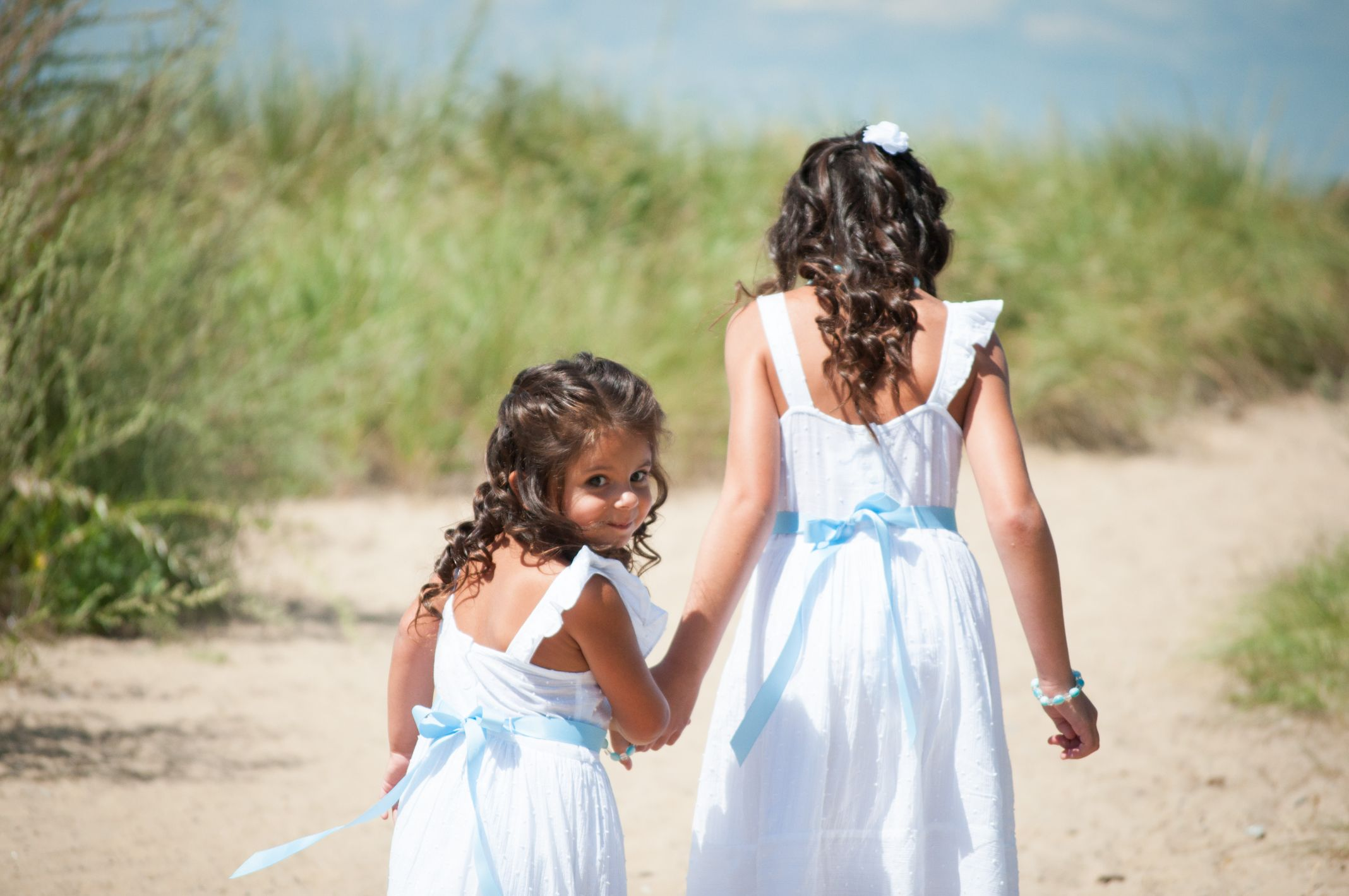 Flower girls white dresses with light blue bows izabella