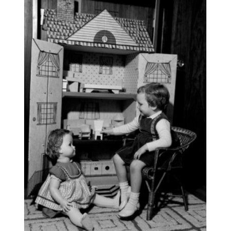 Girl playing with dollhouse Canvas Art - (18 x 24)