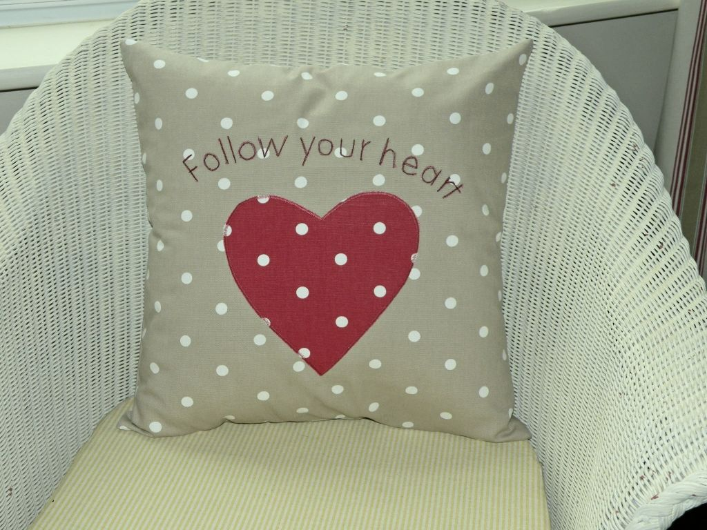 Polka dot follow your heart cushion with heart applique taupe