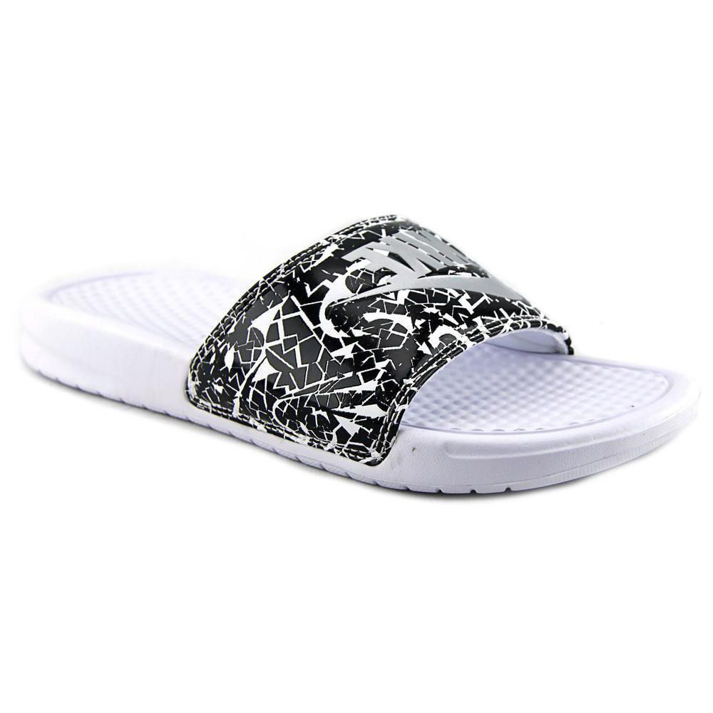 17766a18b8b2 Express your personal style with these fun Nike Women s  Benassi JDI Print   Synthetic Sandals. These bold slides are constructed from synthetic in  white.