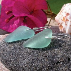 This sea glass is as beautiful as the Caribbean waters from which it emerged. These treasures were found washed ashore on a beach in Rincon, Puerto Rico and were worn smooth only by tropical surf. One piece is a slightly greener aquamarine and the other is slightly bluer which makes them a rather enchanting pair of earrings. The sea glass hangs from ear wires that were hand wrapped in our studio. Handmade ear wires such as this give sea glass earrings an ancient elegance.