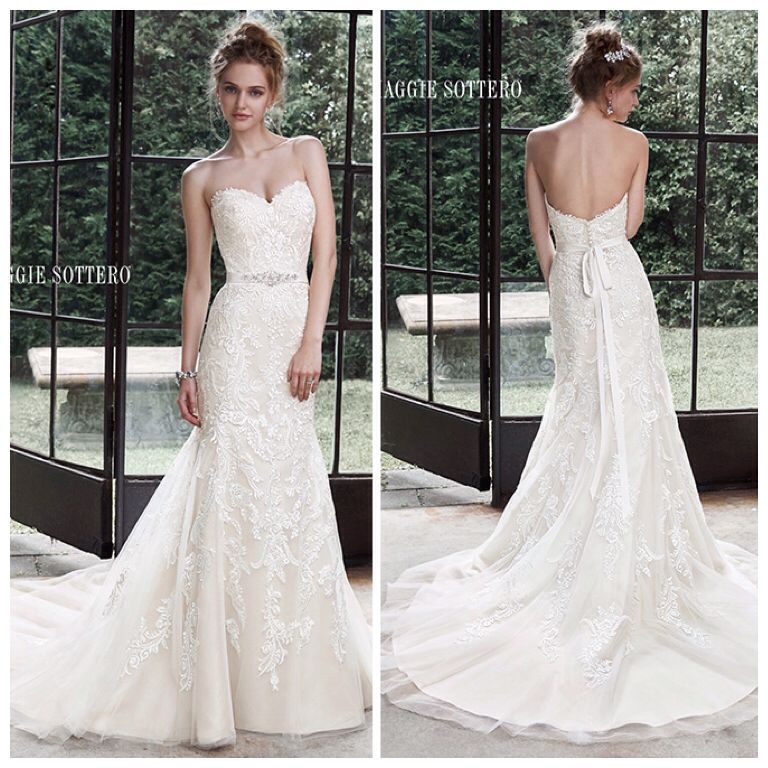 Winstyn - Dreamy lace and tulle combine to create this elegant fit and flare wedding dress, accented with timeless sweetheart neckline. A glittering Swarovski crystal motif on an optional grosgrain ribbon belt adds a touch of drama. Finished with covered buttons over zipper and inner elastic closure. Detachable belt sold separately. Marry & Tux Bridal, Marry & Tux Bridal Shoppe, Marry & Tux Nashua, NH, Marry & Tux