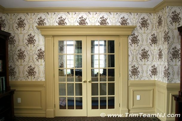 French Doors Trimmed With Fluted Columns And Crown Molding Header.