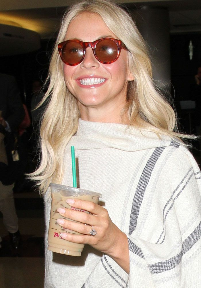 Julianne Hough arrives at the Los Angeles Airport with an iced coffee in hand on September 8, 2016