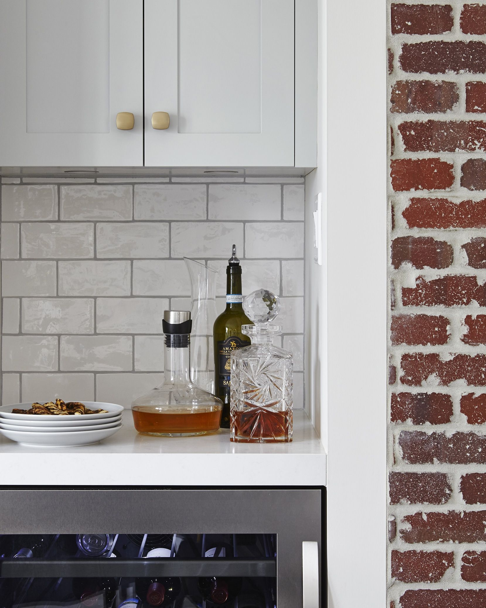 Light Grey Cabinetry Natural Red Brick Walls White Subway Tile Beverage Fridge Orsi Panos Interiors Light Grey Kitchens Grey Kitchen Red Brick Walls