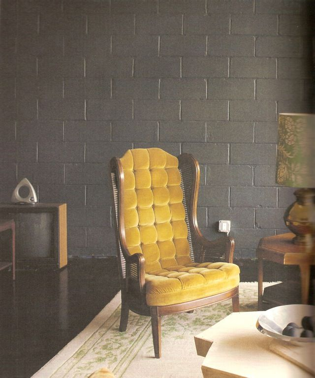 Black Cinder Block Wall With Vintage Yellow Chair