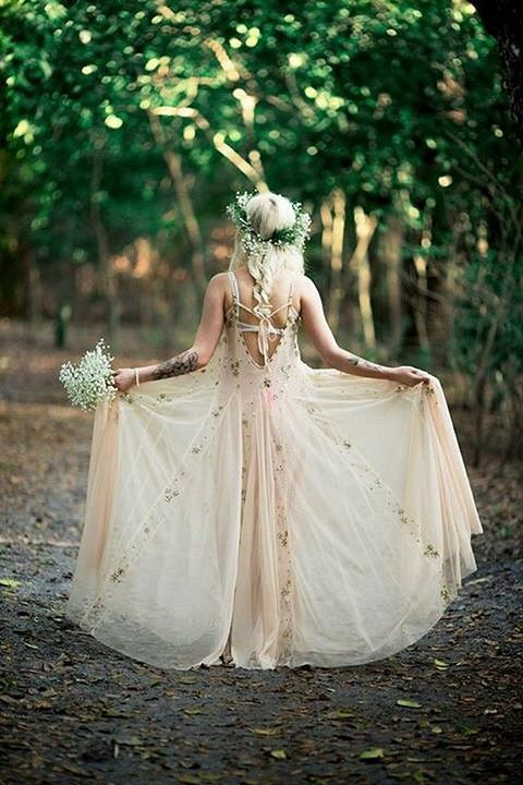 de9a038a7cb ethereal wedding dress in blush with floral patterns and a greenery crown