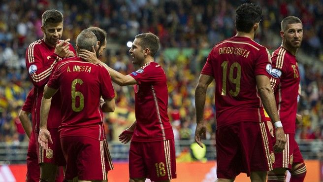 Andrés Iniesta (No6) of Spain celebrates with team-mates after scoring their second goal during their UEFA EURO 2016 qualifier against Slovakia