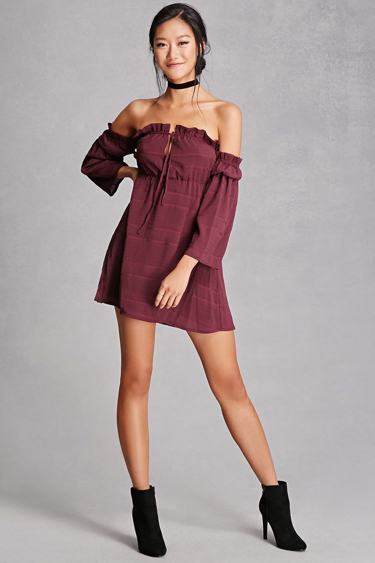 A woven mini dress by tiger mist featuring an offtheshoulder