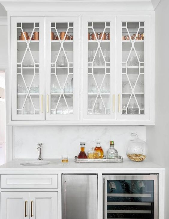 Chic Wet Bar Features White Cabinets Topped With White Marble Fitted With A Round Sink And A Polished Nickel Fauce Kitchen Remodel Kitchen Cabinets New Kitchen