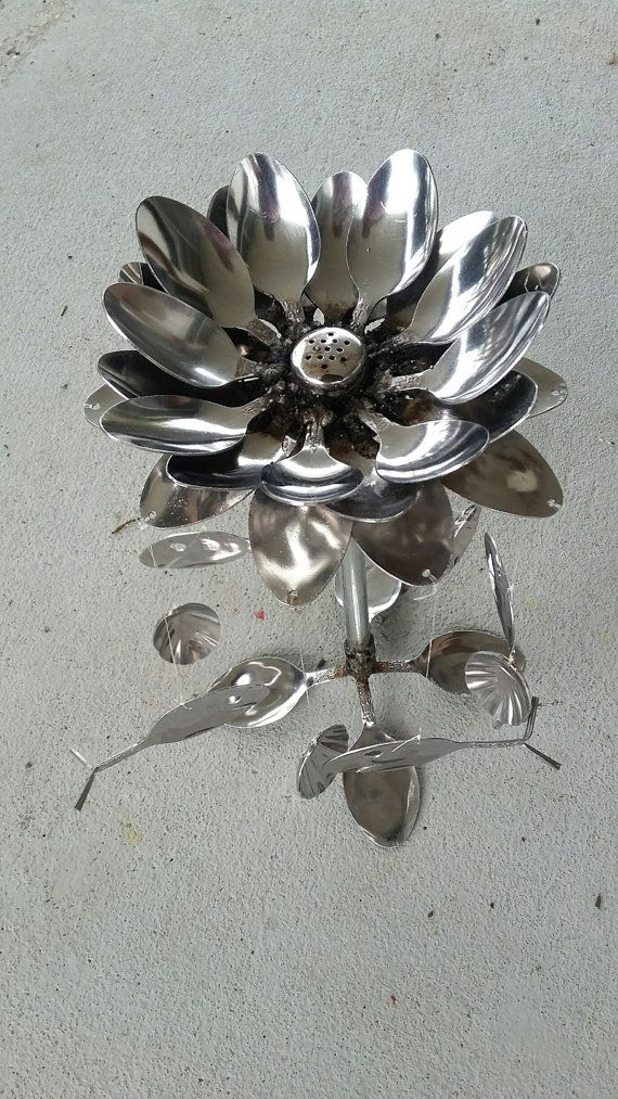 Atop five fish & five shells, this lotus flower gracefully