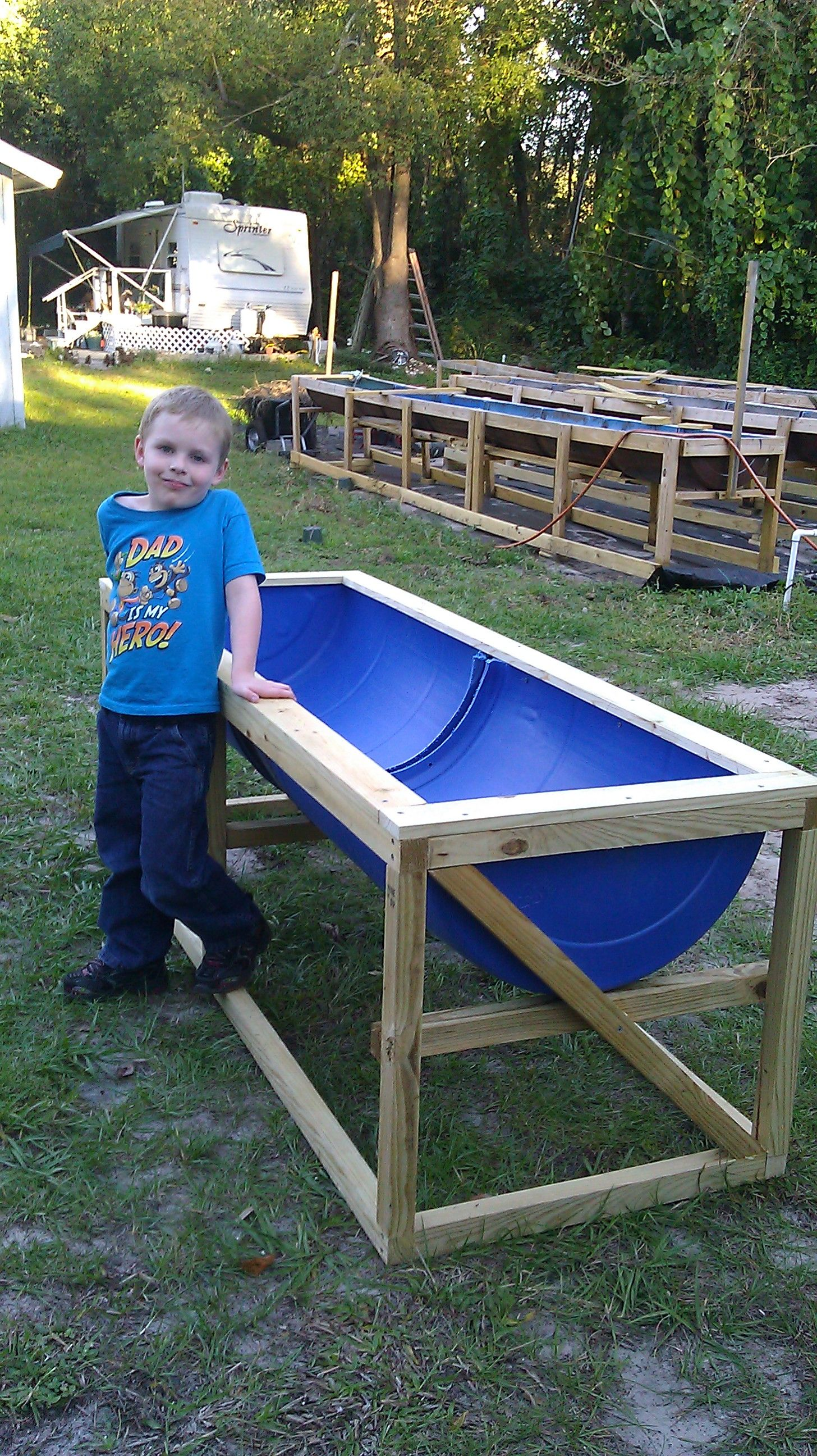Raised beds built for elementary students. Schools are interested in this idea!  What about that Grandson?  I told Dakota he looks like a model!