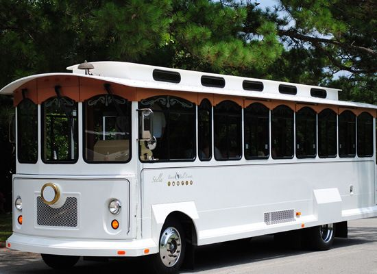 "OBX Trolley - Let ""Stella"" – the OBX Wedding Trolley – transport you in style to all of your events! The OBX Wedding Trolley, affectionately called Stella, is the most elegant form of Outer Banks wedding and special event transportation."