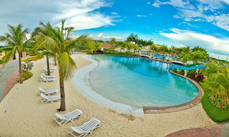 Man made white sand beach in antel grand village antipolo for White sand beach vacations