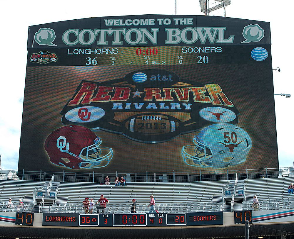 The Cotton Bowl scoreboard reflects the final score of the