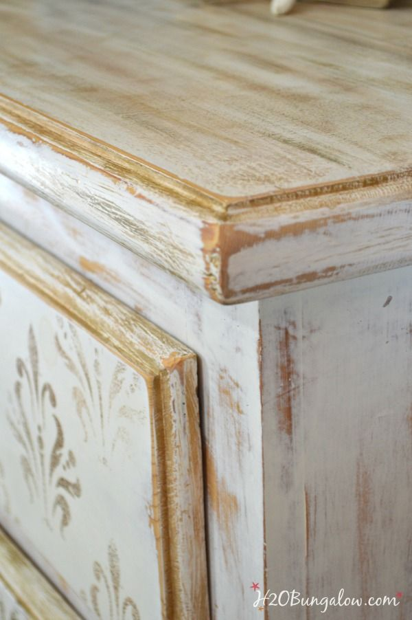 This White And Gold Distressed Damask Dresser Has A Subtle Vintage