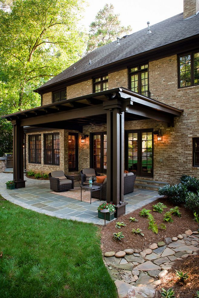 love the rich look of this backyard patio the stone floor has a timeless appeal - Patio Pergola Ideas
