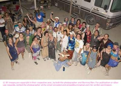 """Volunteering at Burning Man by Caveat Magister """"I am increasingly convinced that the purest expression of the Burning Man spirit isn't an artistic statement or dance party, but the words """"Can I help?"""" said to a complete stranger doing something odd."""""""