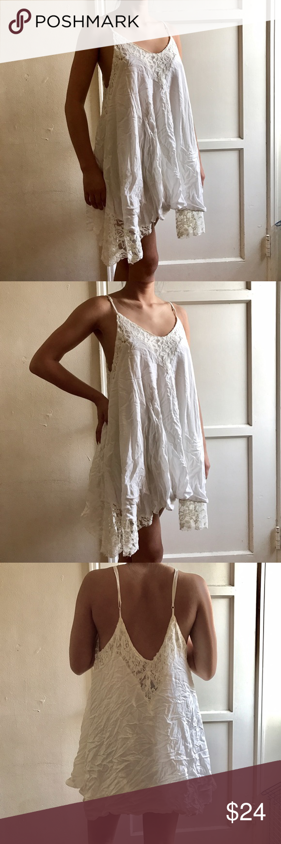 White Lace Rayon Dress Worn once! I apologize for the dress having the wrinkles but that's because the material is rayon. It's super comfy but a little loose on me. It's super cute for special occasions! Willing to negotiate & no trades! Dresses Mini