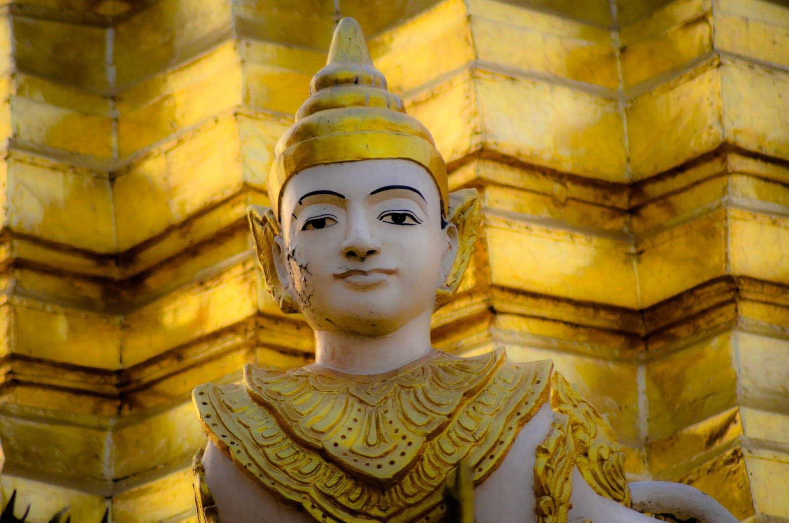 A young Buddha peering down at me. Living in Sin: Yangon, Myanmar - don't miss the Shwedagon Pagoda - it is gorgeous
