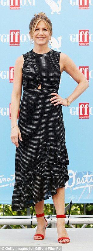 Jennifer Aniston looks super chic in polkadot dress