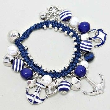 Nautical By The Sea World Silver Tone Anchor Navy Blue and White Crystal Accent  Bracelet. Get the lowest price on Nautical By The Sea World Silver Tone Anchor Navy Blue and White Crystal Accent  Bracelet and other fabulous designer clothing and accessories! Shop Tradesy now