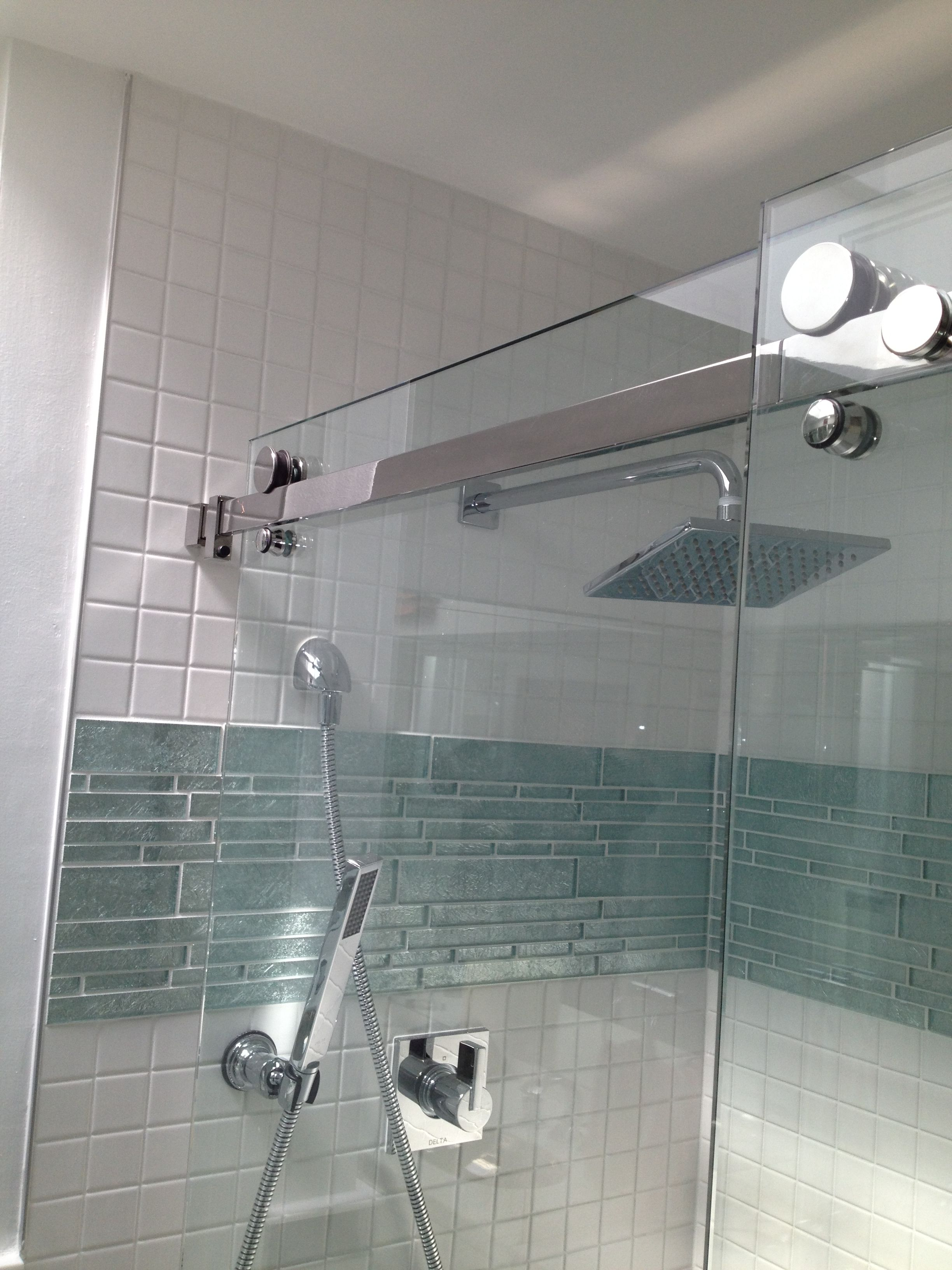 Bathroom Remodel Glass Tile accent band just above center (and is that a shower version of a
