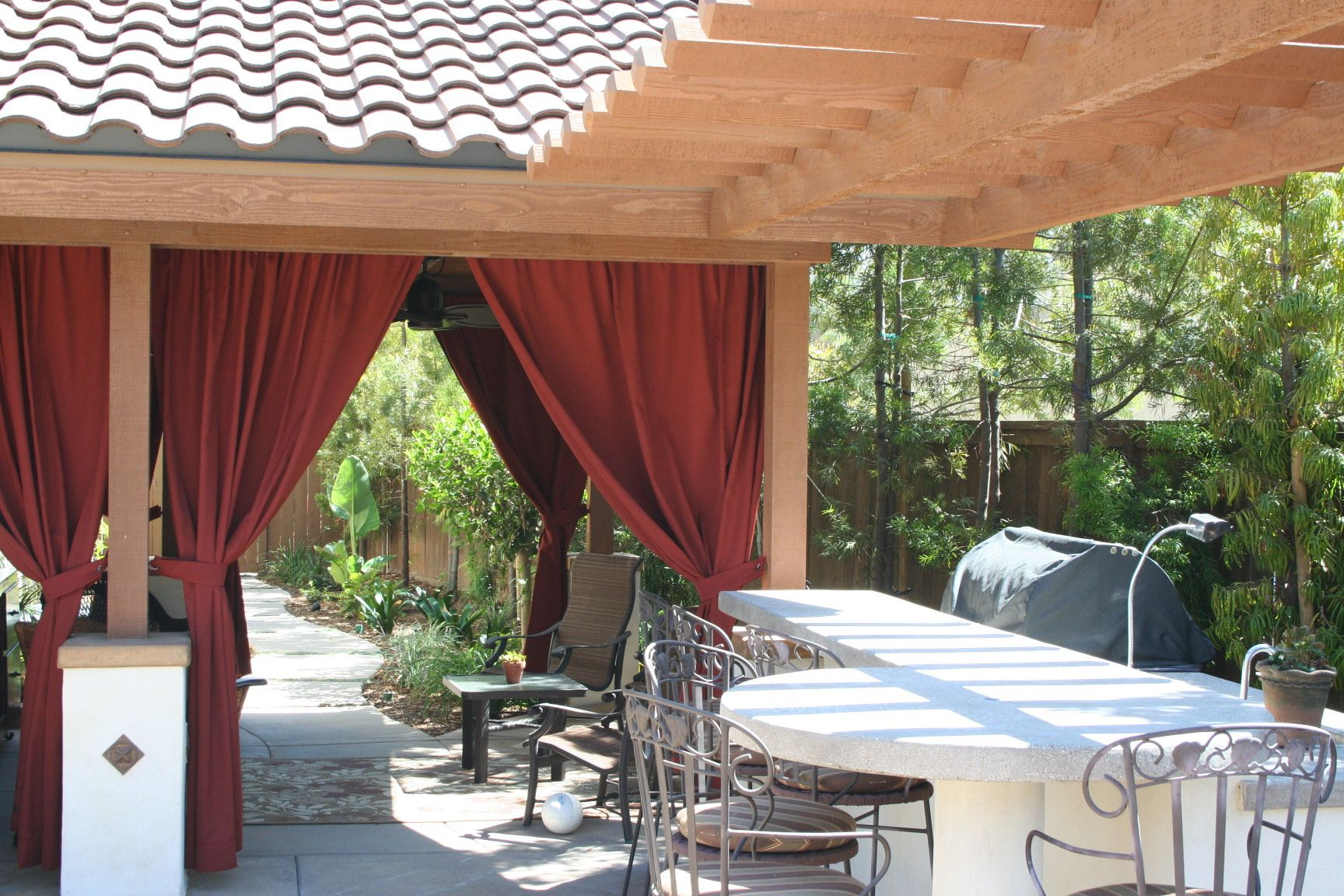 Exterior Kitchen with attached shade lounge complete with ... on Attached Outdoor Living Spaces id=90640