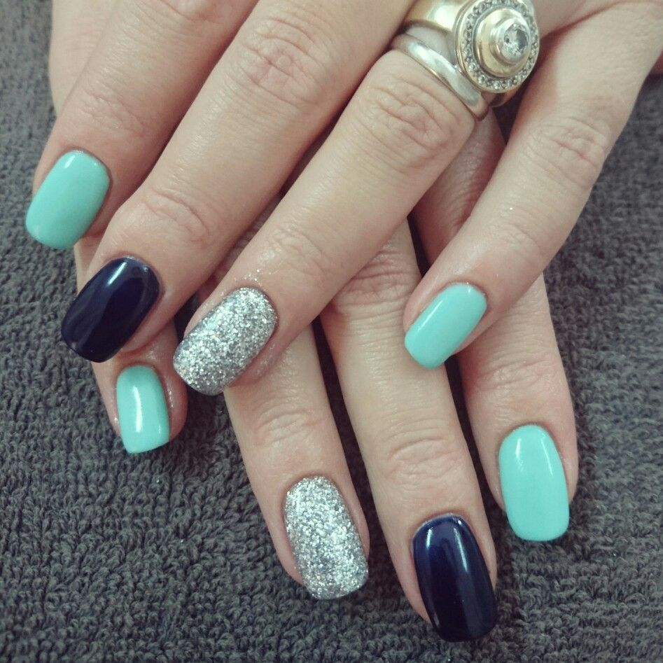 mint and navy nails with silver