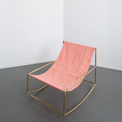 This Rocking Chair by Muller Van Severen has a brass frame and a pink fabric seating. The design is minimalistic yet exquisite and blends in well in varied interiors.Fien Muller and Hannes Van Severen have been on an inspired quest for sculpturally interesting furniture objects since 2011. A broad selection of their work has now been collected as part of the new Valerie Objects label, an initiative by Veerle Wenes, Axel Van den Bossche and Frank Lambert. Being ornamental and functional at…