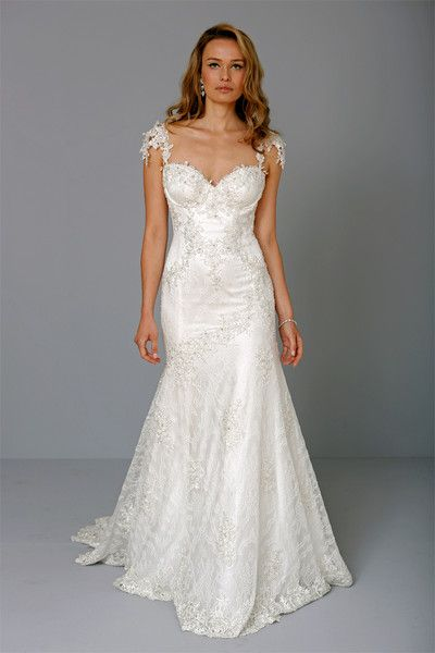 ff744a32c6b43 Sweetheart Mermaid Gown in Beaded Lace This mermaid gown features a  sweetheart neckline with in beaded lace. It has a chapel train and cap s.