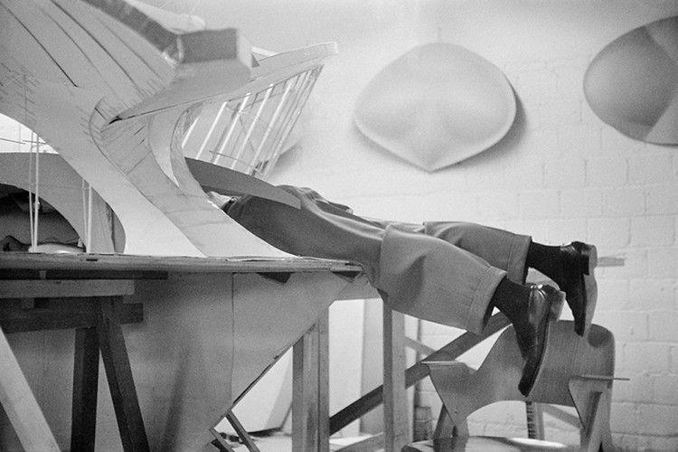 Eero Saarinen waist-deep in his model of the TWA Terminal at Idlewild (now JFK), late 1950s. Via, photo (C) Balthazar Korab.