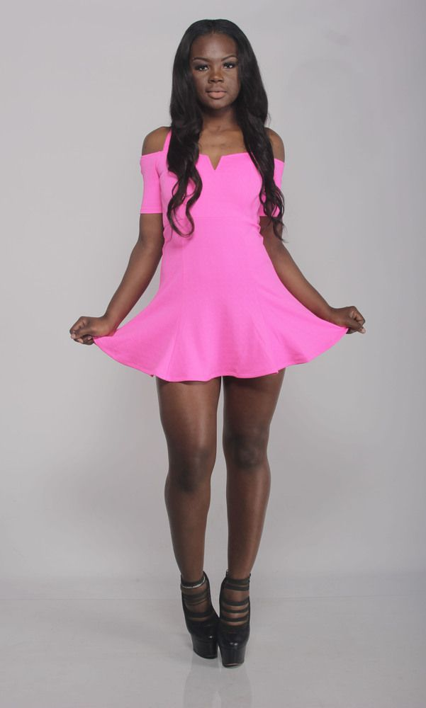 ff4ed386e2d5 This playful pink skater dress comes with a slight v-cut neckline and off -the-shoulder design with straps. You got it