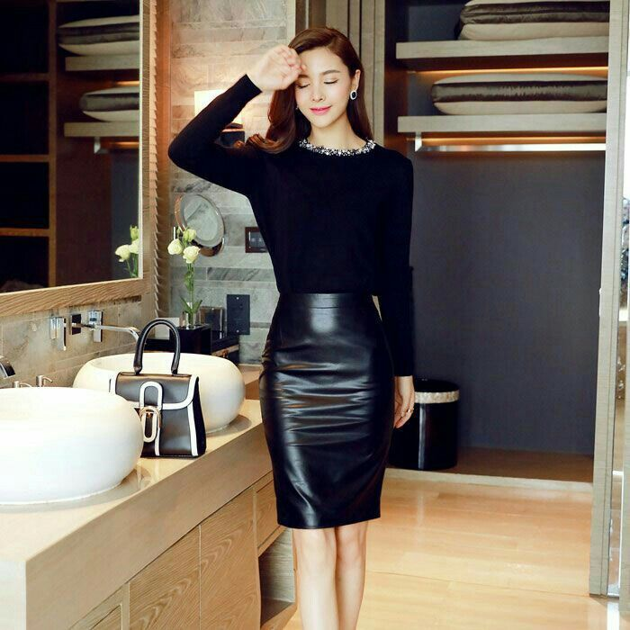 1498d51cbd Asian girl in black leather skirt in the kitchen