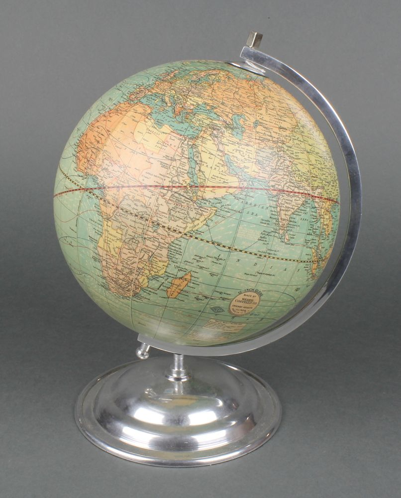 """Lot 226, A Webber Costello Company 12"""" terrestrial globe on a chrome base, sold for £65"""