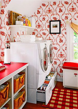 pretty up your laundry room with a fresh palette. Red-and-white wallpaper, a checked rug, and a red countertop make this space fresh and inviti