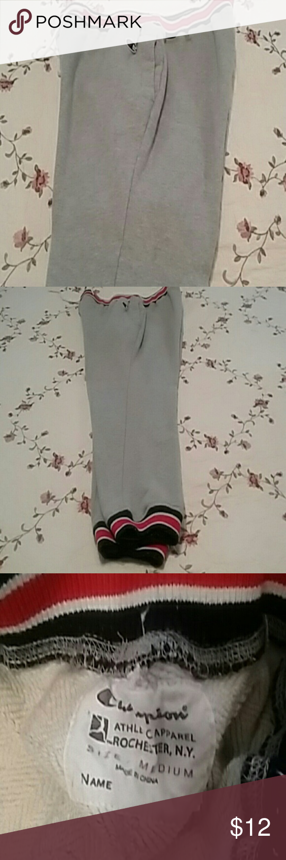 Men's sweats They are size medium have pockets and are a thicker material. They are grey with red, blue and white stripes around the waist and feet. These sweats are in great condition. They have a little lent on the waist but that can be removed. The string is still in the waist line also. Champion Pants Sweatpants & Joggers