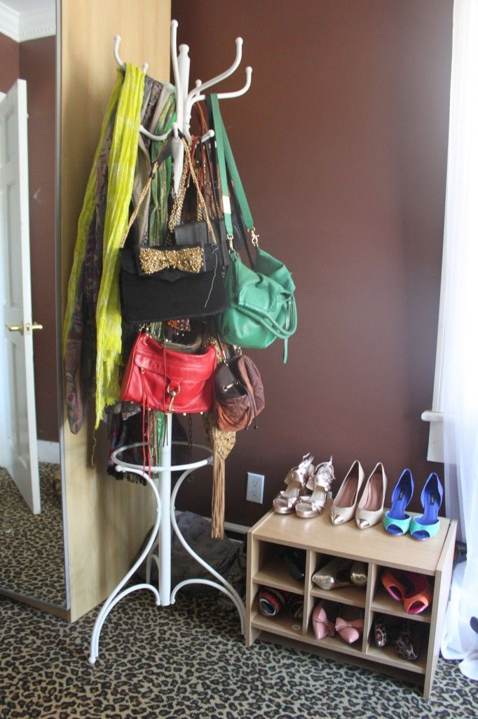 Open storage for shoes and bags (on a coat rack!) with leopard carpet