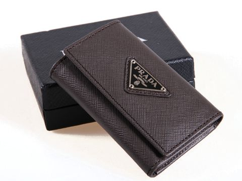 "Prada KP5052 Coffee Key Holders - Saffiano leather. - Dual snap closure. - 6 Key Holders - The interior is embossed with ""PRADA MILANO"". Size(WxHxD): 10 x 6 x 2 cm Prada KP5052 Coffee Key Holders comes with: original box, care booklet, Prada dust bag, Prada Card, tag."