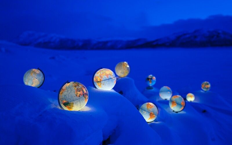 world globes in snow
