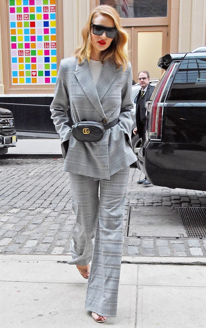 0969d142a16e ROSIE HUNTINGTON-WHITELEY wearing a gray plaid pantsuit, a black Gucci  fanny pack and clear sandals in N.Y.C. - March 2018