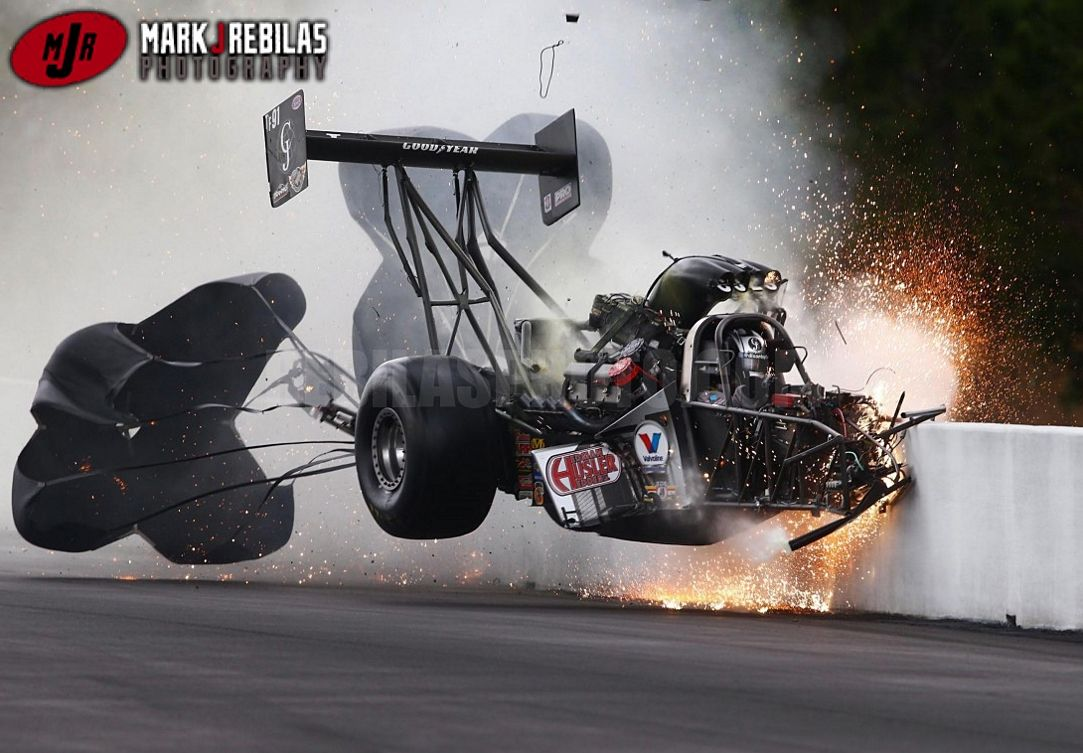 Nhra driver larry dixon crashes after his car broke in half during qualifying for the gatornationals at auto plus raceway in gainesville florida
