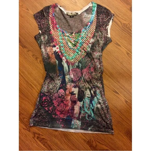 Guess top size small See through top with bright colors, the design is unique and very trendy. Fits a small/x-small. Excellent condition! Guess Tops
