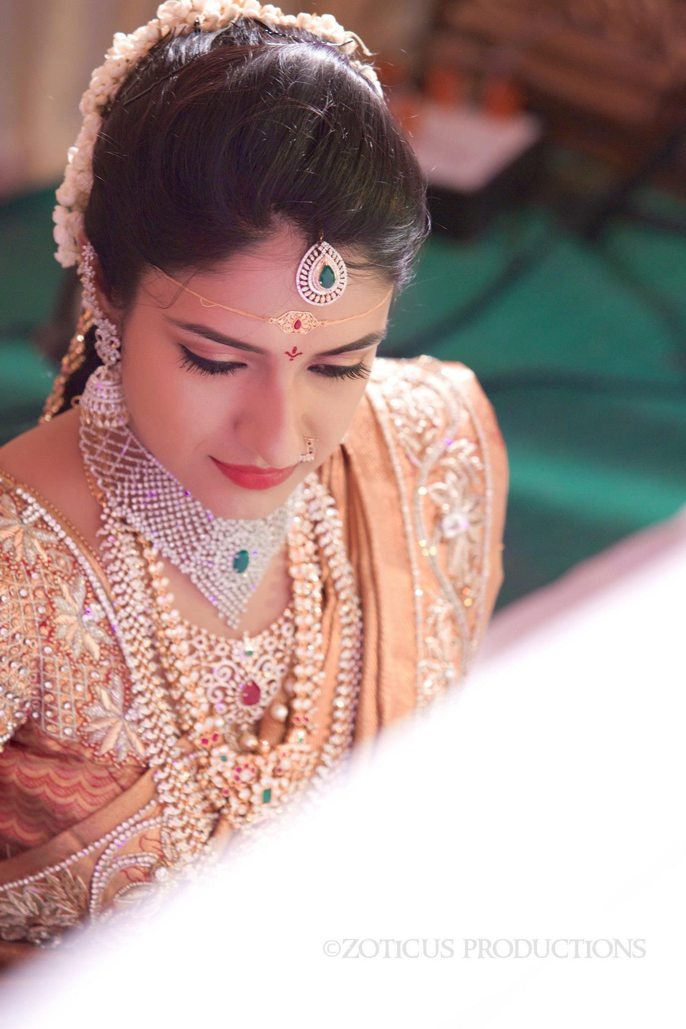 South Indian bride. Indian diamond bridal jewelry. Jhumkis.Gold silk ...